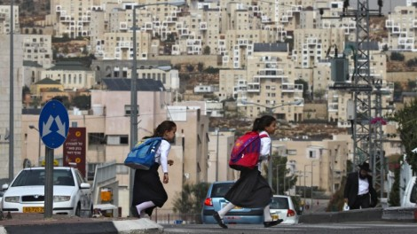 A dearth of public spaces. Ultra-Orthodox girls cross the street on their way to school in Kiryat Sefer (photo credit: Nati Shohat/Flash90)