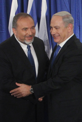 Benjamin Netanyahu and Avigdor Liberman at the announcement of the new Likud-Yisrael Beytenu alliance last week. Can the left follow suit with its own bloc party? (photo credit: Miriam Alster/Flash90)