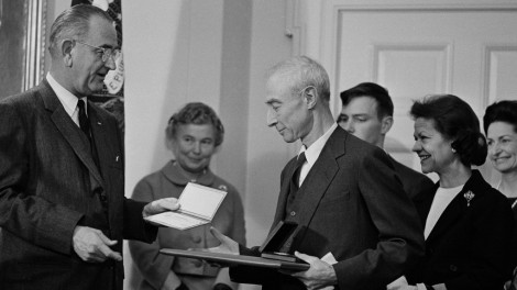 """Robert Oppenheimer, """"father of the A-bomb,"""" with President Lyndon Johnson, 1963 (Photo credit: AP)"""