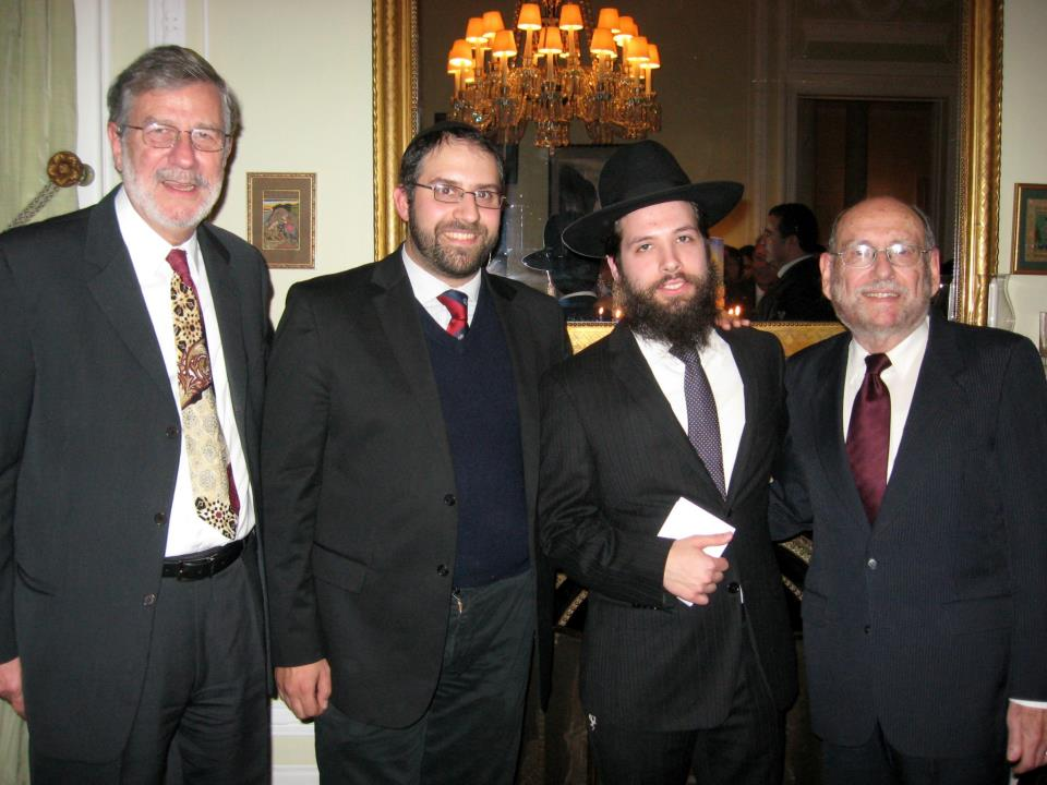 Masorti Rabbi Jules Harlow (right) attends a Chanukah reception hosted by U.S. Ambassador to Portugal Allan Katz  along with the Orthodox and Chabad rabbis in Lisbon