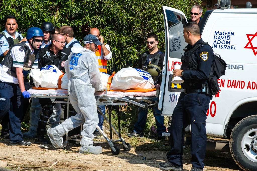Evacuating the dead following a rocket attack on Kiryat Malachi, November 15, 2012 (photo: David Katz)