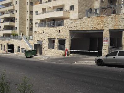 Garage-dominated streetscape in one of Jerusalem's newer neighborhoods (photo: Julie Rosenzweig)
