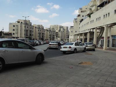 Car-oriented shopping strip in one of Jerusalem's newer neighborhoods (photo: Julie Rosenzweig)