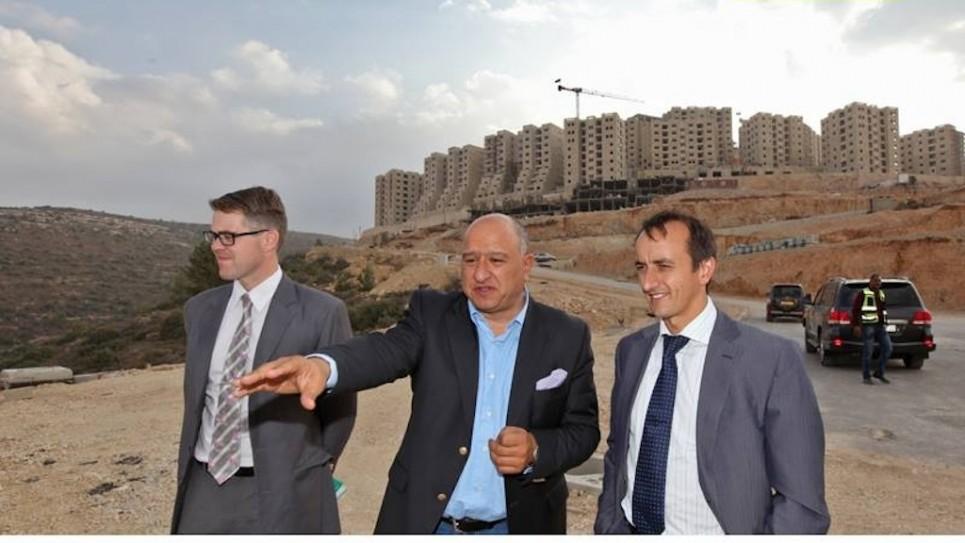Australian Ambassador Dave Sharma, (R), Australian representative in Ramallah Tom Wilson (L) at the planned Palestinian city of Rawabi, with Amir Dajani of the Massar International team (Photo: courtesy)