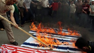 American and Israeli flags being burnt in Gaza