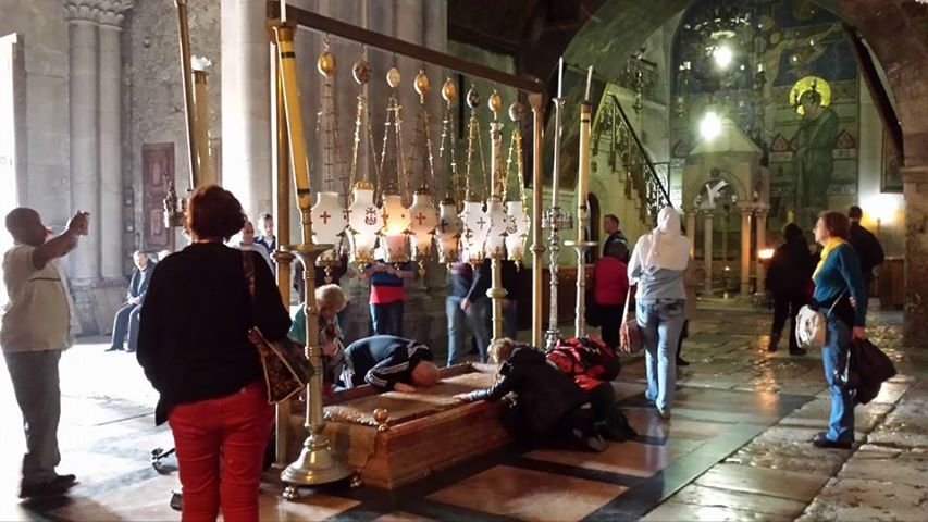 The devoted pray at the Church of the Holy Sepulcher.  Photo by Irene Rabinowitz