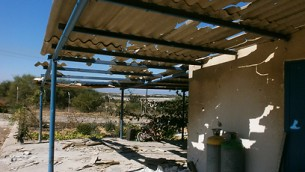 Damaged asbestos roof in Israel (photo credit: Yael Revivo, Ynet)