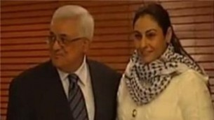 Palestinian leader Mahmoud Abbas smiles in the company of Amna Muna, the terrorist who lured 16-years-old Ofir Rahum to his death