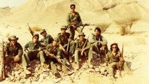 Kipp Friedman (pictured second from the right) while at a remote Israeli army youth training base in the Negev desert during his summer of 1978 teen trip to Israel. His friend James is standing in the center background.