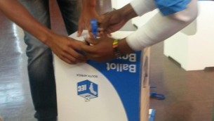 Sealing ballot boxes during the national elections 2014.