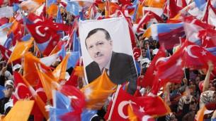 AKP rally - holding Turkish Prime Minister, Tayyip Erdogan's poster