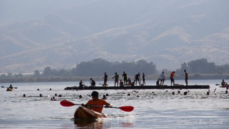 Women taking a break on the floating docks. Photo credit: Laura Ben-David