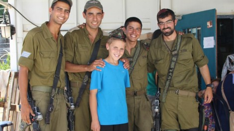 Yoni Katz, 13, with IDF soldiers at the Pina Chama. Photo credit: Laura Ben-David