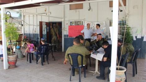 Gush Etzion mayor light blue shirt, standing) surveys the Pina Chama. Photo credit: Laura Ben-David