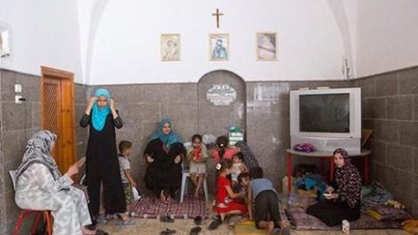 Palestinians find refuge inside central Gaza City's Church of St. Porphyrius, July 22, 2014. PHOTO: Anne Paq/Activestills.org