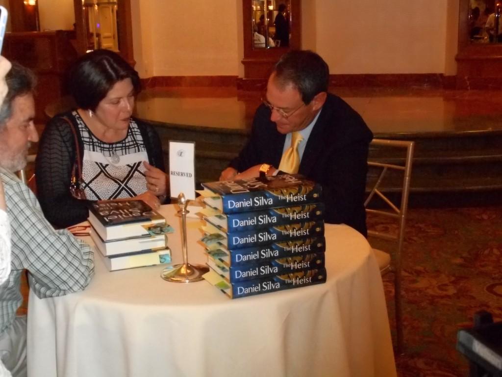 Daniel Silva signing his latest book the Heist