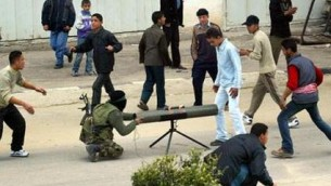 Operating from within a crowd. Hamas militants.