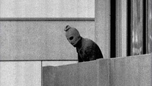 """Terrorist holding hostage Israeli athletes at the 1972 Munich Olympics """"Ap munich905 t"""" by Russell McPhedran - © 1972 The Associated Press. All Rights Reserved. Licensed under Fair use of copyrighted material in the context of Munich massacre via Wikipedia - http://en.wikipedia.org/wiki/File:Ap_munich905_t.jpg#mediaviewer/File:Ap_munich905_t.jpg"""