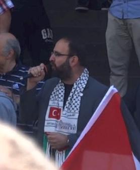 "New minister of housing Mehmet Kaplan proclaiming  ""We will liberate Jerusalem"" photo:Tobias Petersson"