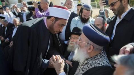 Jerusalem's chief rabbi Shlomo Amar shakes hands with an imam