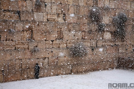 snow falling at the western wall