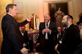 David Cameron lighting the Chanukah candles at No.10