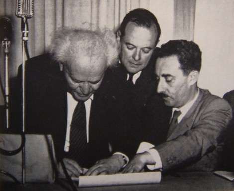 Ben-Gurion (left) signing Israel's Declaration of Independence held by Moshe Sharet at the Tel Aviv Museum on May 14, 1948