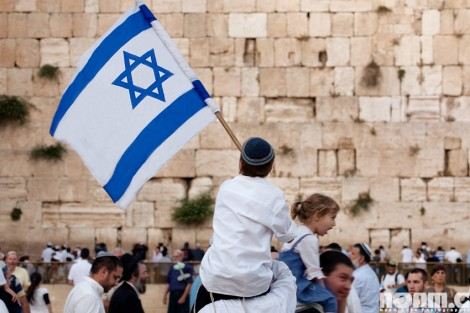 child with israeli flag at western wall