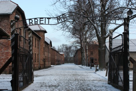 """Entrance to the labor camp of Auschwitz I, with the infamous """"Work Make's Freedom"""" sign into the camp."""