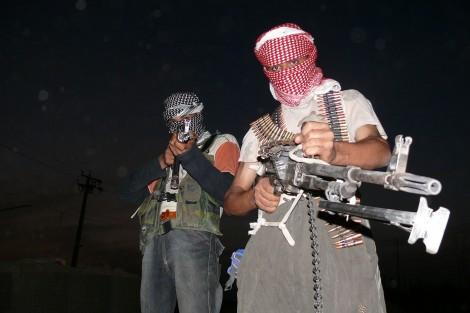 """Iraqi insurgents with guns"" by Menendj - http://ar.wikipedia.org/. Licensed under CC BY-SA 2.5 via Wikimedia Commons - http://commons.wikimedia.org/wiki/File:Iraqi_insurgents_with_guns.JPG#mediaviewer/File:Iraqi_insurgents_with_guns.JPG"