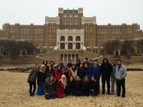 Participants of the Bridges: Muslim-Jewish Interfaith Dialogue trip taking a break to visit Little Rock Central High School, site of the forced desegregation of public school systems.