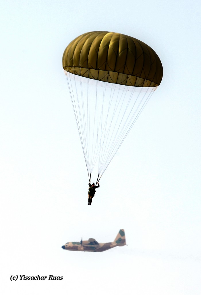 """Paratrooper coming in for a landing with his """"Mothership"""" in the background"""