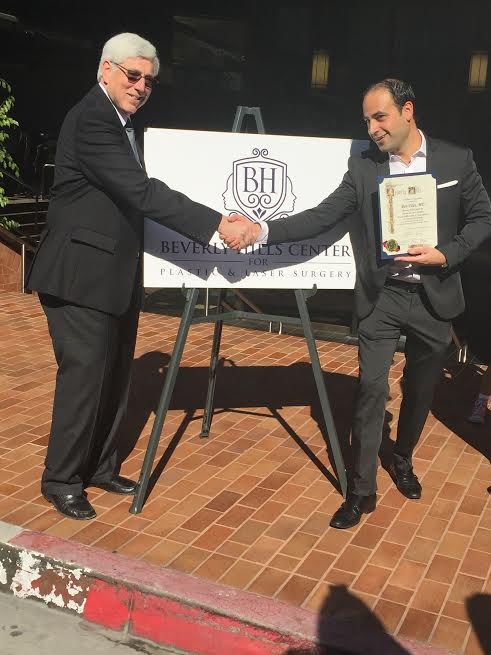 Beverly Hills Mayor, Dr. Julian A. Gold, MD and Dr. Ben Talei-in front of the Clinic sign-Photo N Greenger