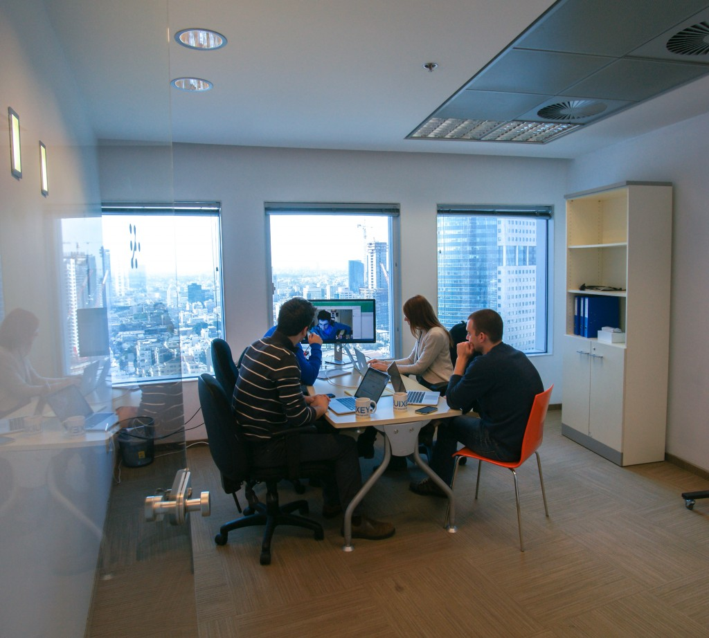 The team at work, video conferencing between ten time zones.