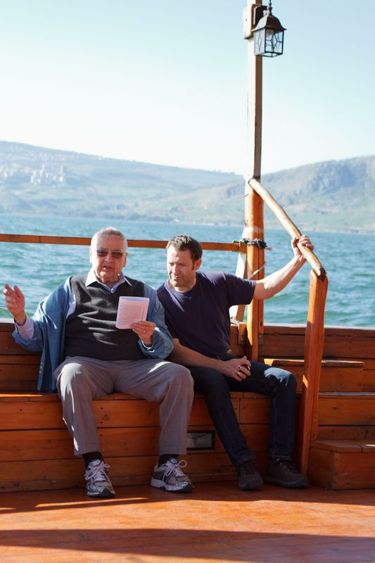 Bill Harter, with a fellow pilgrim, on the Sea of Galilee.