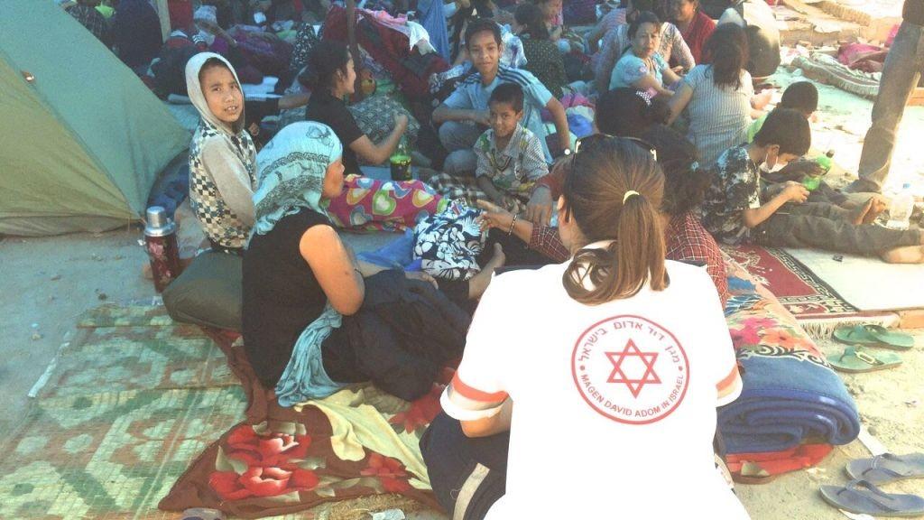 Israeli Magen David Adom volunteer providing medical aid in nepal