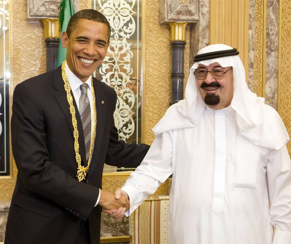 Obama re-assuring the (now dead and buried) King Abdullah of Saudi Arabia {public domain}