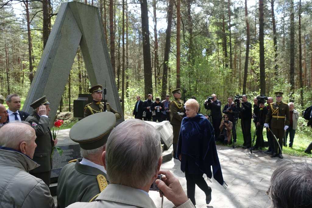 Lithuania's president Dalia Grybauskaite at the Holocaust mass murder site Ponar outside Vilnius paid tribute at a monument to a group of Lithuanian fascists who volunteered for pro-Nazi police service and were then shot for alleged desertion. It was part of the government's chosen program for commemorating the seventieth anniversary of the end of World War II.  PHOTO: DefendingHistory.com.