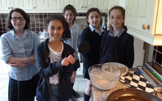 Manchester: Members of the local UJIA Ethiopian Bar/Bat Mitzvah Programme make traditional Injara bread.