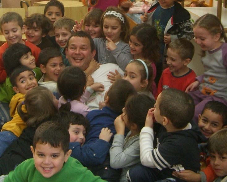 """Above: Stuart Ballan, author of """"Who Invented Vegetables?"""", drowning in a sea of happy kids, after a book reading"""