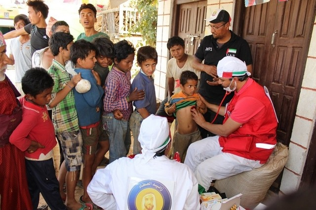 Care being given after the quake by one of the thousands of volunteers in the capital city