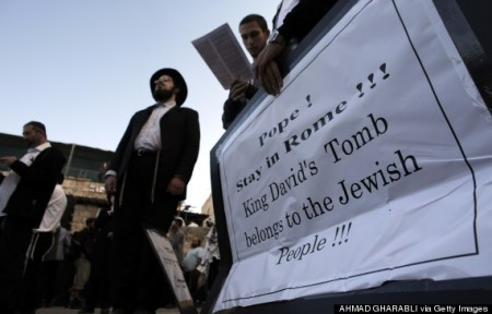 Ultra-Orthodox Jewish men protest Christian presence at King David's Tomb, Old City of Jerusalem photo: AHMAD GHARABLI/AFP/Getty Images)