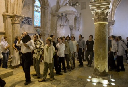 Jewish extremists protest at the Cenacle, or Upper Room, on Mount Zion just outside the Old City of Jerusalem, against Christian pilgrims praying there for Pentecost, on June 9, 2014 .The Cenacle, or Upper Room, on Mount Zion is in a two-story building considered holy to both Christians and Jews, who regard it as the place where the biblical figure David was buried. photo: AHMAD GHARABLI/AFP/Getty Images)