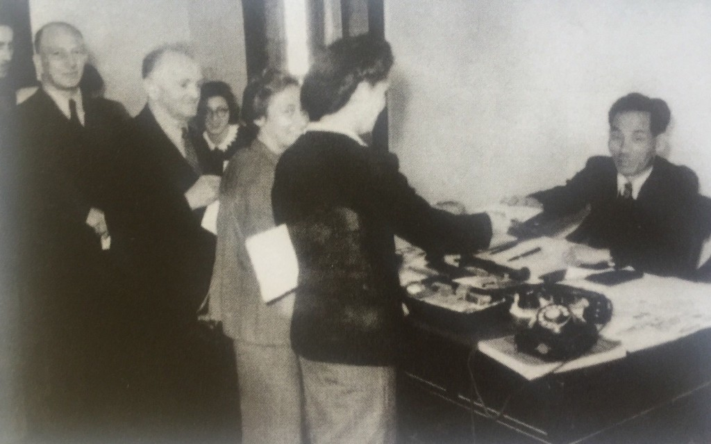 """Ghoya, the Japanese head of Hongkew Ghetto (and self-described """"King of the Jews""""), distributing passes to the refugees who earned their living outside the ghetto (Photo Credit: CC - BY Beth Hatefutsoth, The Nahum Goldmann Museum of the Jewish Disapora ed., Passage Through China, The Jewish Communities of Harbin, Tientsin and Shanghai)"""