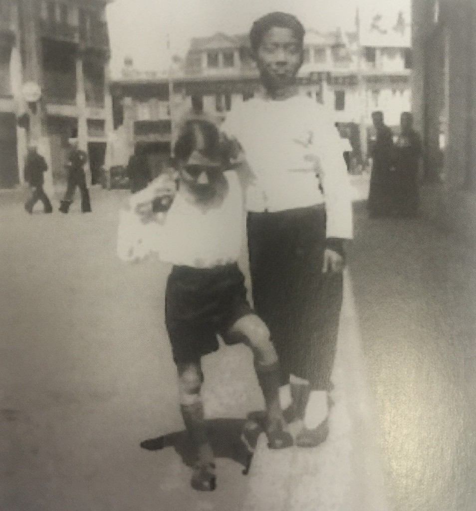 A German Jewish child with a Chinese boy in front of the cafe Europe on Bubbling Well Road, Shanghai (CC - BY Hans Jorysz, Shanghai Jewish Refugees Museum)
