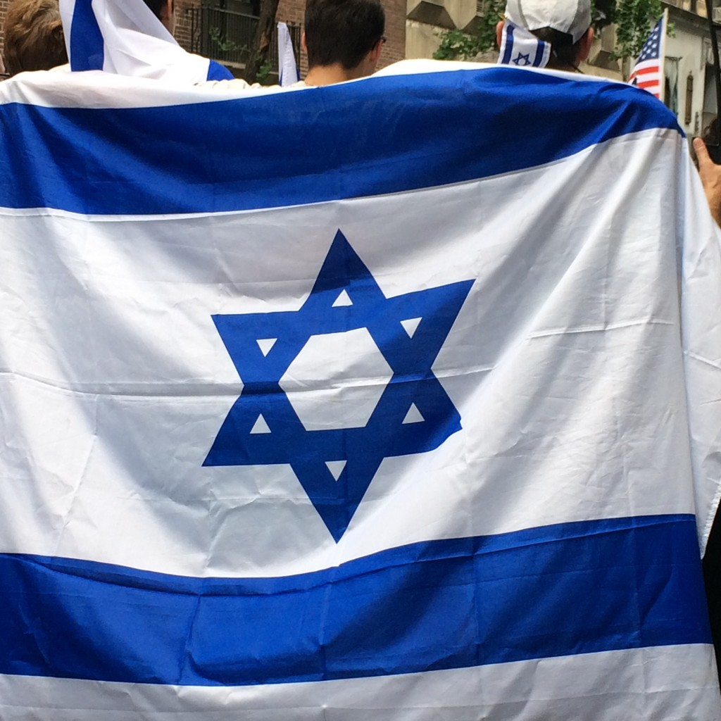 Teen draped with Israeli Flag - Israel Day Parade, New York City, 2015
