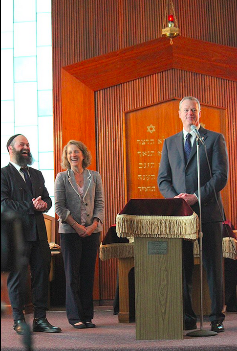 Governor Charlie Baker shares a light a moment at Gala. With Rabbi Yossi Lipsker and First Lady Lauren Baker.