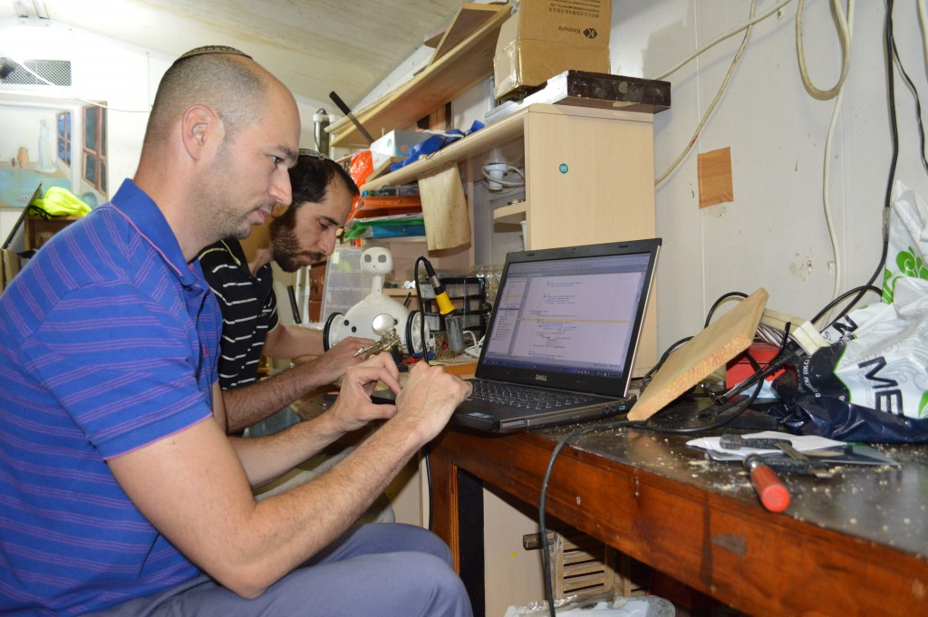 Brothers Shlomo and Elazar Schwarcz at work with Robit.