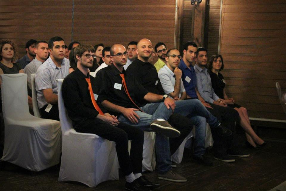 Entrepreneurs getting ready to pitch. Note the men in orange.