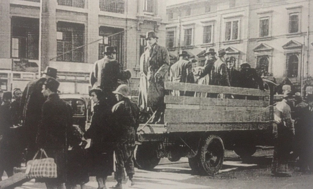 Refugees being loaded onto trucks (Photo Credit: CC - BY Shanghai Jewish Refugees Museum)
